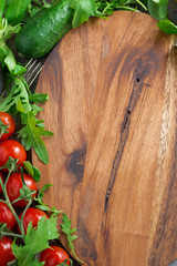 wooden board background, fresh lettuce and tomatoes