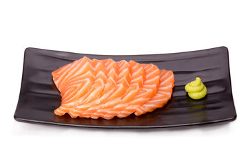 Cut raw salmon fat (salmon sashimi) on plate isolated on white