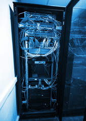 Modern server cabinet with network equipment and wires