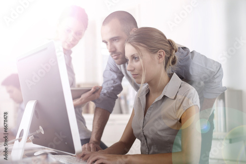 Business people working on project in office - 66711478