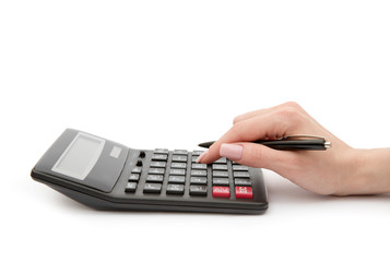 Woman's hands counts on the calculator