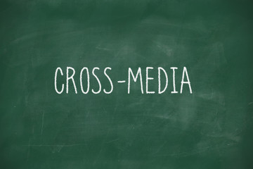 Cross mediahandwritten on blackboard