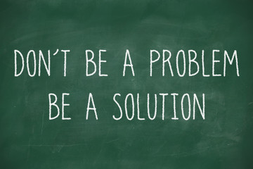 Dont be a problem handwritten on blackboard
