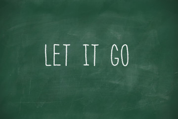 Let it go handwritten on blackboard
