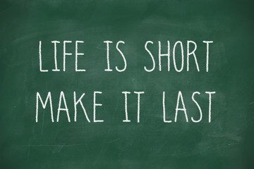 Life is short make it last handwritten on blackboard