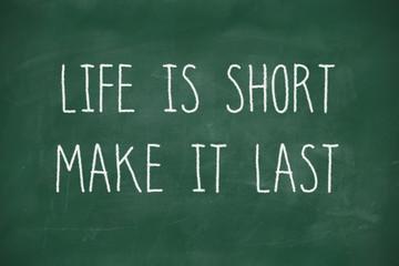 Life is short make it last handwritten on blackboard