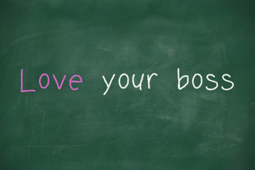 Love your boss handwritten on blackboard