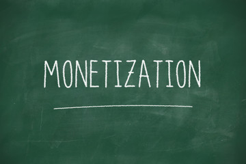 Monetization handwritten on blackboard