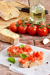 Tomato bruschetta - bread sandwich with tomatoes, garlic