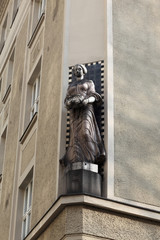 Sculpture of woman on corner of the building