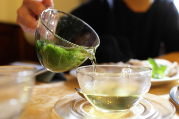 Woman pouring mint tea