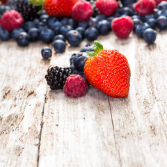 Fruit on wooden background.