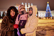Portrait of family at walk on frosty winter evening