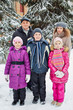Family of five stands outside in winter