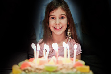 Portrait of little girl with birthday cake