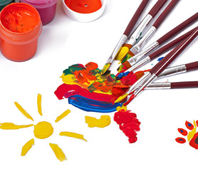 paint brushes with paint on white background