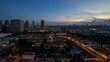 Постер, плакат: Time lapse of sunset over Kampong Glam with Singapore cityscape