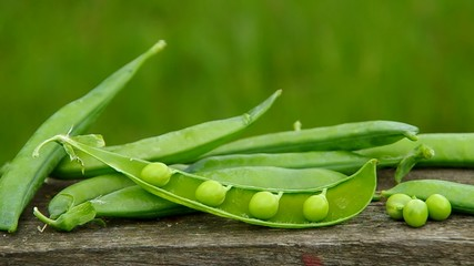 Ripe green peas on a wooden table
