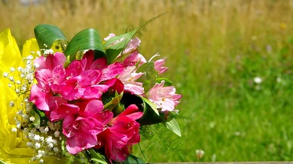 Bouquet of flowers on a background of green meadows