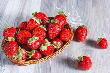 Fresh strawberries on wood background