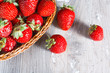 Fresh strawberries on wood background