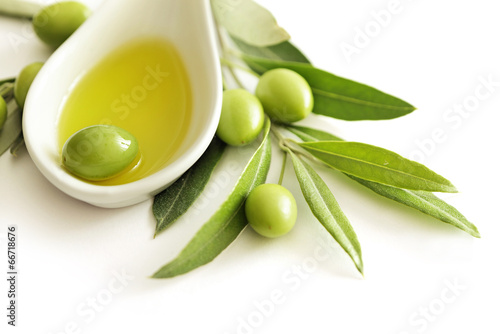 olive oil and green olives isolated - 66718676