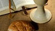 bible with chalice and bread, panning,sliding, tilt