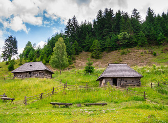 Old wooden houses and mountains