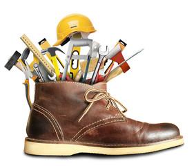 Tools and construction helmet in a big Shoe