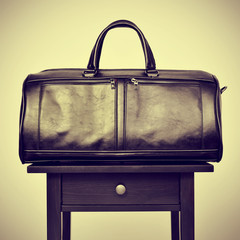 leather bag on a table, with a retro effect