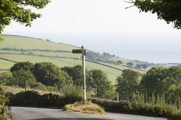 Signpost at Pond Green in Bigbury south Devon England UK
