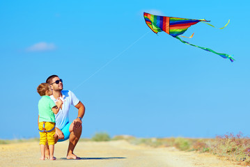 family playing with kite, summer vacation