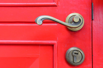 old vintage door handle on red door