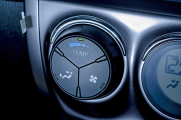 air conditioning button inside a car .Blue-toned