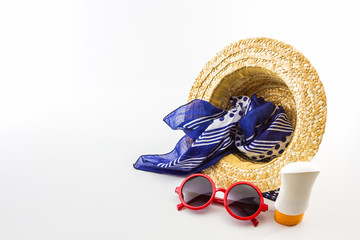 Woven hat, red sunglasses, scarf with body lotion.
