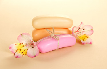 Heap of toilet soap with a rope and the flowers