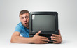 Bearded man with a old TV