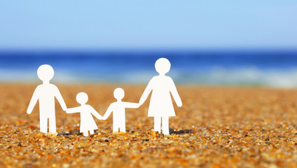 Paper Family on the beach. Family Concept