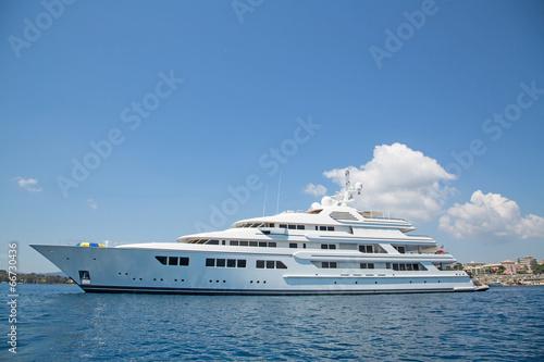Leinwandbild Motiv Luxury large super or mega motor yacht in the blue sea.