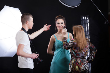 Make-up artist working during photo session