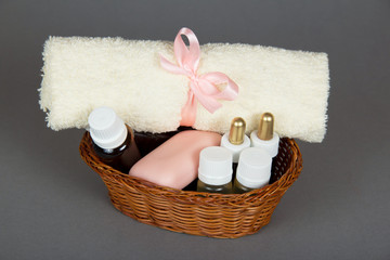 Hotel cosmetics kit and terry towel in basket