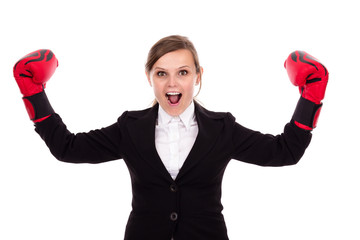 Young successful businesswoman celebrating wearing boxing gloves