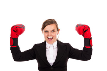 Successful  businesswoman celebrating wearing boxing gloves