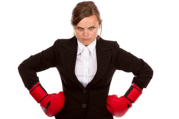 Young businesswoman standing with hands on hips wearing boxing g