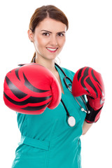 Female doctor with boxing gloves, challenge concept
