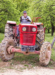 Young farmer driving his tractor