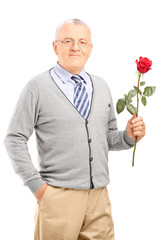 Mature gentleman holding a red rose