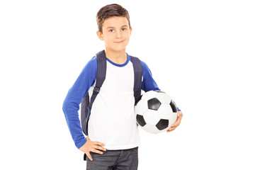 Kid with backpack holding a football