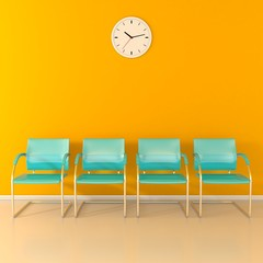 Four blue stools in the yellow waiting room