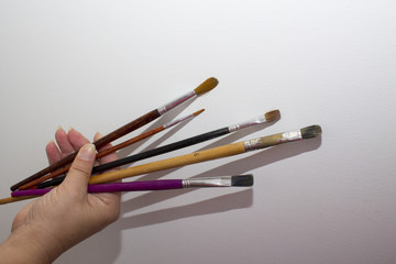 hand with brushes
